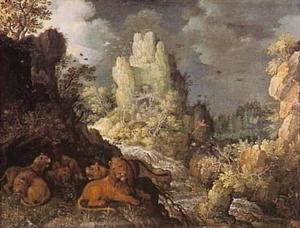 Woest berglandschap met  een groep l;eeuwen