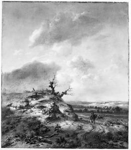 Duinlandschap met een ruiter op een karrenspoor