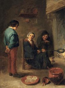 Interieur met twee boeren en een vrouw die pannenkoeken bakt