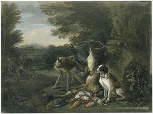 Honden bij jachtbuit in een landschap, jagers in de achtergrond