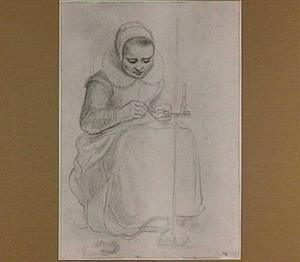Naaiende vrouw bij kaarslicht