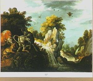 Rotslandschap met waterval en gevecht tussen een vos en twee runderen