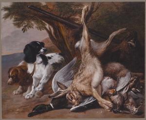Twee honden bij een stilleven van jachtbuit in een landschap