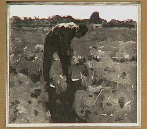 Spittende boer op het land