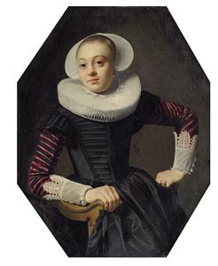 Portret van een onbekende jonge vrouw zittend in een armstoel