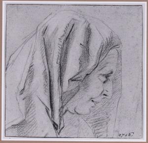 Kop van een oude vrouw met hoofddoek