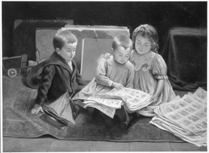 Drie kinderen in het atelier die een plaatjes boek bekijken