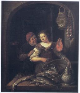 Een man en een jonge vrouw met vis in een venster