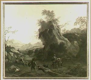 Zuidelijk berglandschap met herders en hun kudde op weg