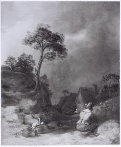 Heuvellandschap met zittende man
