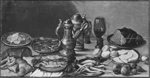 Stilleven met etenswaren en vaatwerk op een tafel