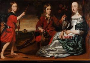 Groepsportret van twee jongens en een jonge vrouw in een landschap