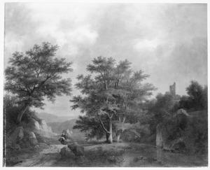 Heuvelachtig boslandschap met ruïne