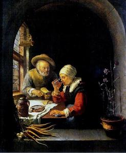 Een oud paar aan hun maaltijd
