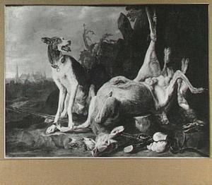 Hond bij buit van hert, haas en gevogelte in een landschap