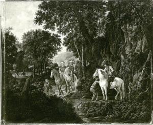 Groep ruiters in het bos