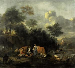 Boomrijk landschap met herders bij een meertje