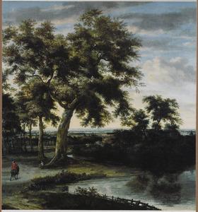 Boslandschap met een ruiter onderweg langs een water