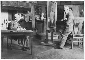 Hendrik van Borssum Buisman schildert een portret van Adolf van Kerkwijk in het atelier aan de Bakenessergracht 84 in Haarlem