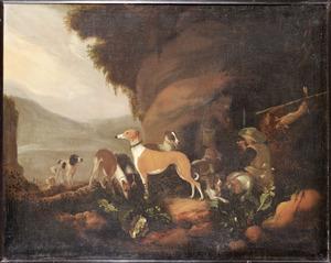 Landschap met rustende jagers en hun honden bij een rots