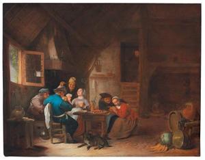 Kaartend boerengezelschap in een interieur
