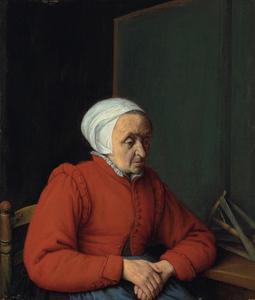 Oude vrouw aan een tafel