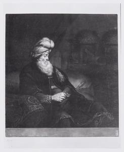 Half figuur van een zittende man met een tulband