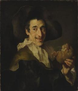 Lachende man met een varkensworst in de hand