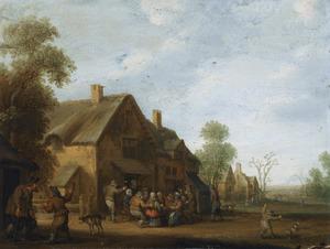 Gezicht in een dorpsstraat, met een boerengezelschap voor een herberg