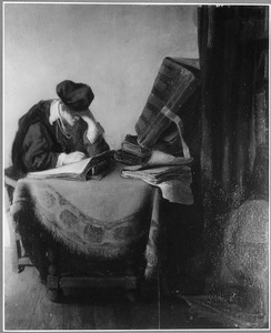 Jonge lezende man in een studeervertrek