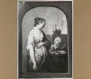 Moeder met een etend kind in een interieur