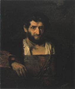 Man met baard en een gouden ketting