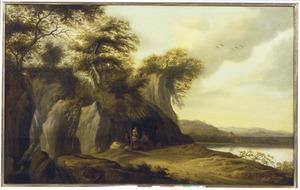 Landschap met een koopman die zijn waren aanbiedt onder een afdak aan de waterkant
