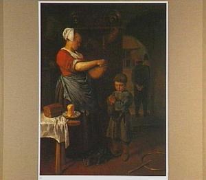Jongen bidt voor hij brood krijgt van een keukenmeid die kaas snijdt