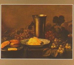 Stilleven met tinnen beker, druiven en twee borden met gebak en boter