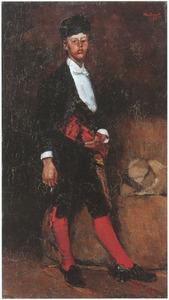 Een jonge man gekleed in een Spaans kostuum