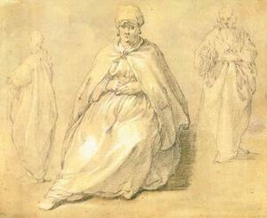 Zittende vrouw en twee staande mannen