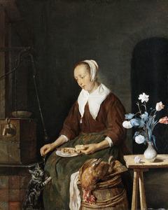 Vrouw die een kat voert
