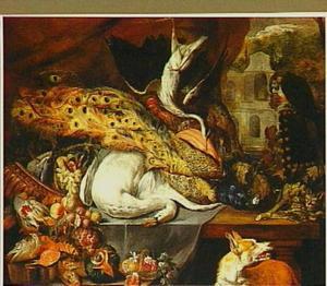 Stilleven van gevogelte en vruchten met een hond, een kat en een papegaai; rechts een doorzicht
