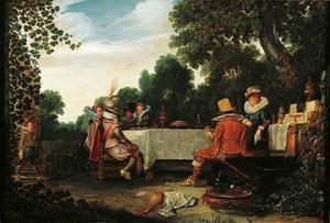 Elegant gezelschap aan een maaltijd in een tuin