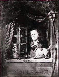 Een vrouw met vogelkooi en hondje
