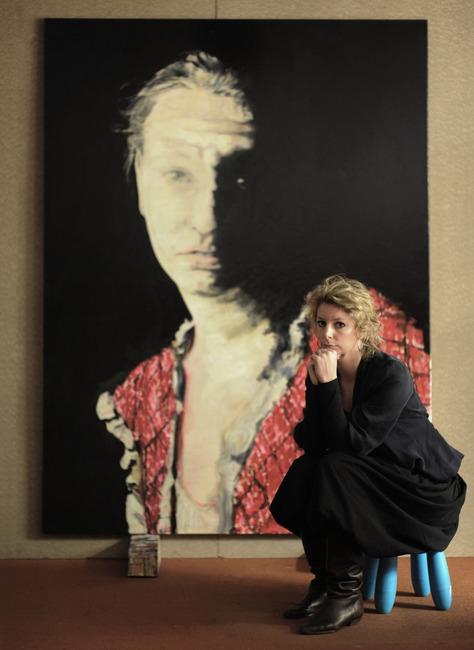 Annemiek Vera with one of her paintings in her studio
