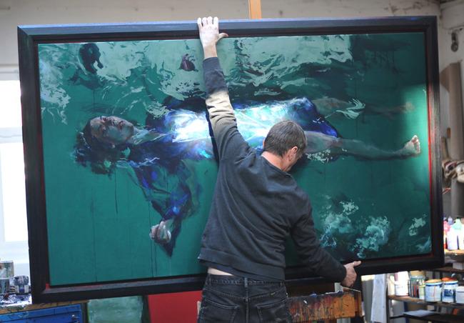 Sam Drukker with painting in his studio