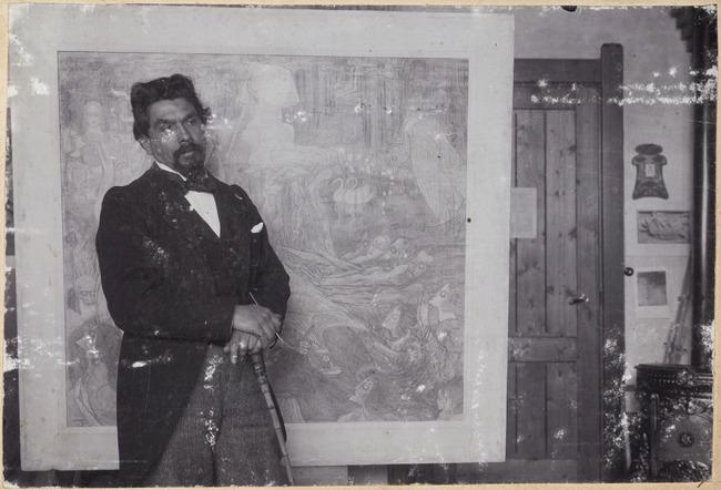 Portrait of Jan Toorop (1858-1928) in his studio in the background his work 'De Sphinx'