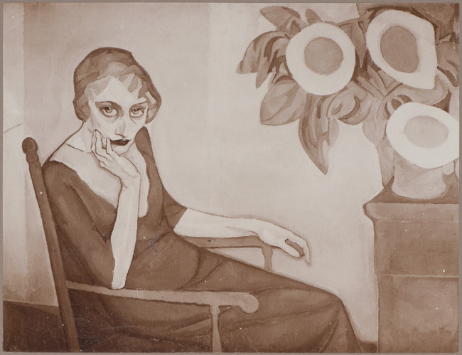 Woman seated with sunflowers